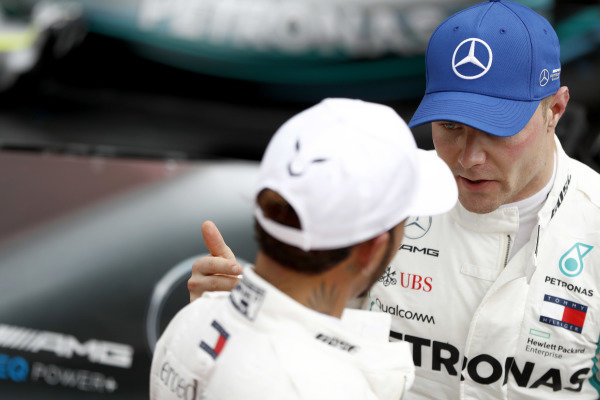 Valtteri Bottas, Mercedes AMG F1, talks to pole man Lewis Hamilton, Mercedes AMG F1