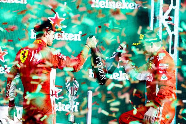 Sebastian Vettel, Ferrari, 2nd position, and Kimi Raikkonen, Ferrari, 3rd position, celebrate on the podium