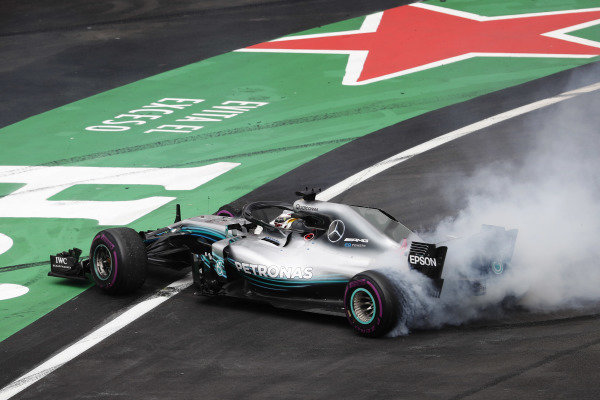 Lewis Hamilton, Mercedes AMG F1 W09 EQ Power+, performs a doughnut as he celebrates winning his fifth World Chamionship