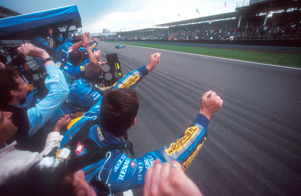 1995 British Grand Prix. Silverstone, England. 14-161 July 1995. The team celebrate as Johnny Herbert (Benetton B195 Renault) takes 1st position for his maiden Grand Prix win. Ref-95 GB 19. World Copyright - LAT Photographic