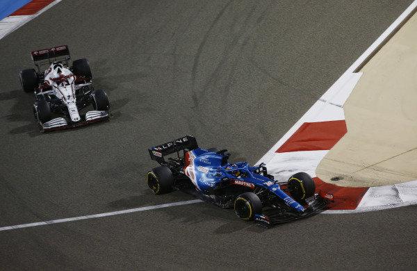 Fernando Alonso, Alpine A521, leads Kimi Raikkonen, Alfa Romeo Racing C41