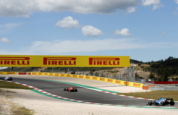 Max Verstappen, Red Bull Racing RB16B, leads Fernando Alonso, Alpine A521