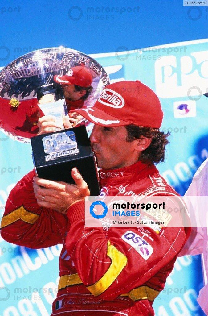 Fedex World Series Champion Alex Zanardi (ITA) kisses the championship trophy to celebrate his victory. CART Fedex World Series, Vancouver, Canada. 6 September 1998.