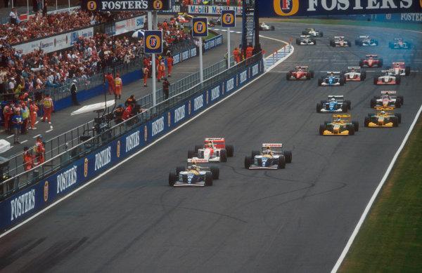 1993 British Grand Prix.Silverstone, England.9-11 July 1993.Damon Hill leads Alain Prost (both Williams FW15C Renault's), Ayrton Senna (McLaren MP4/8 Ford), Michael Schumacher, Riccardo Patrese (both Benetton B193B Ford's), Martin Brundle (Ligier JS39 Renault) and Johnny Herbert (Lotus 107B Ford) at the start. Ref-93 GB 01.World Copyright - LAT Photographic