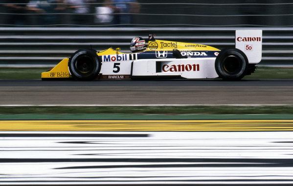 Race winner Nigel Mansell (GBR) Williams FW11B. Formula One World Championship, Rd2, San Marino Grand Prix, Imola, Italy, 3 May 1987.