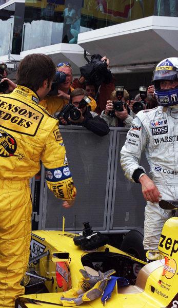 Nurburgring, Germany. 24-26 September 1999.Heinz-Harald Frentzen (Jordan Mugen Honda) takes pole position for the European Grand Prix. David Coulthard (McLaren Mercedes) looks on.World Copyright - Tee/LAT Photographic