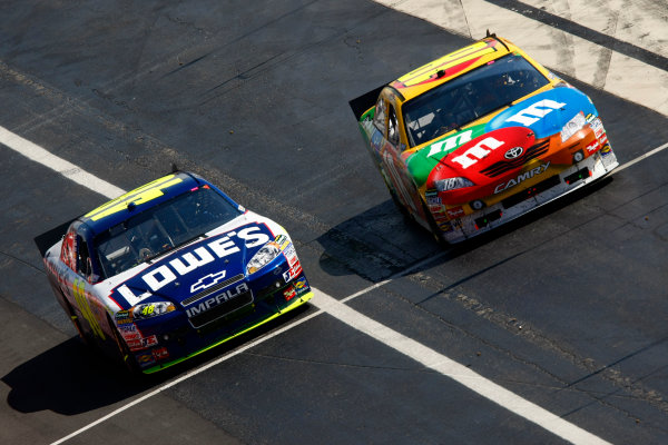 14 - 16 May 2010, Dover, Delaware USAKyle Busch and Jimmie Johnson race down pit road© 2010 - LAT South USALAT Photographic