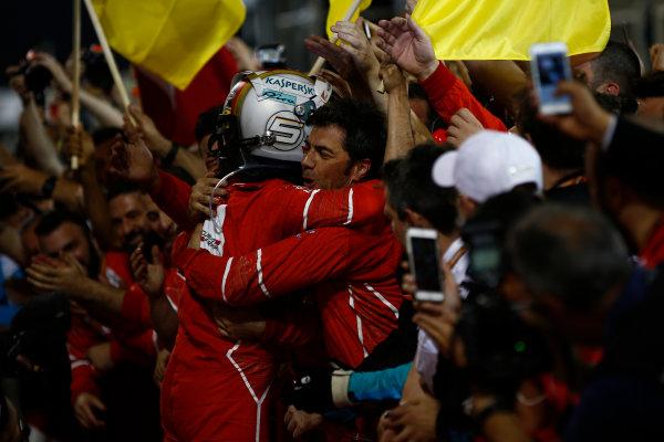 Bahrain International Circuit, Sakhir, Bahrain.  Sunday 16 April 2017. Sebastian Vettel, Ferrari, 1st Position, celebrates in Parc Ferme with his team. World Copyright: Andrew Hone/LAT Images ref: Digital Image _ONY8465