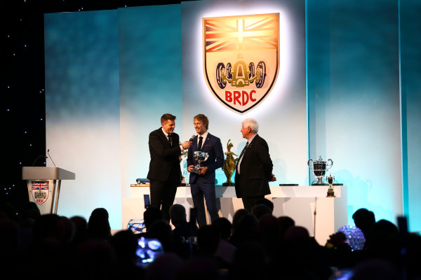 2017 British Racing Drivers Club Awards. London Hilton Hotel, Park Lane, London. Monday 4th December 2017. Jake Humphrey, Brendon Hartley and Howden Ganley. World Copyright: Jakob Ebrey / LAT Images. Ref: Hartley-04