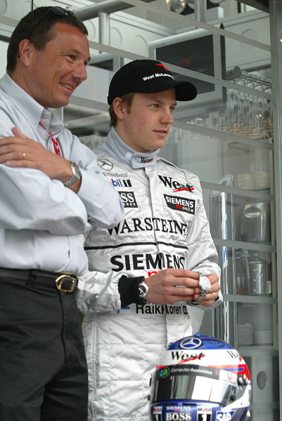 2003 Spanish Grand Prix - Sunday Race,Barcelona, Spain.4th May 2003.Kimi Raikkonen, Team McLaren Mercedes MP4/17D, is presented with the new TAG Heuer link watch to commemorate his first Formula One win in the 2003 Malaysian Grand Prix.World Copyright LAT Photographic.ref: Digital Image Only.