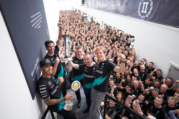 Mercedes AMG Constructors Championship Celebration Brackley, Northants, UK Monday 12th October 2015 Lewis Hamilton, Mercedes AMG, Nico Rosberg, Mercedes AMG, Toto Wolff, Executive Director (Business), Mercedes AMG, Paddy Lowe, Executive Director (Technical), Mercedes AMG and Andy Cowell, Managing Director, HPP, Mercedes AMG line up with the team in the factory. World Copyright: Steve Etherington/LAT Photographic ref: Digital Image SNE22337