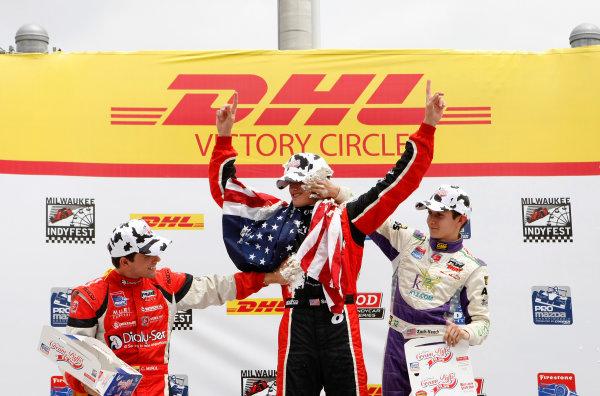 14-15 June, 2013, West Allis, Wisconsin USA Sage Karam, Zach Veach and Carlos Munoz Celebrate on  the podium with cream puffs ©2013, Phillip Abbott LAT Photo USA