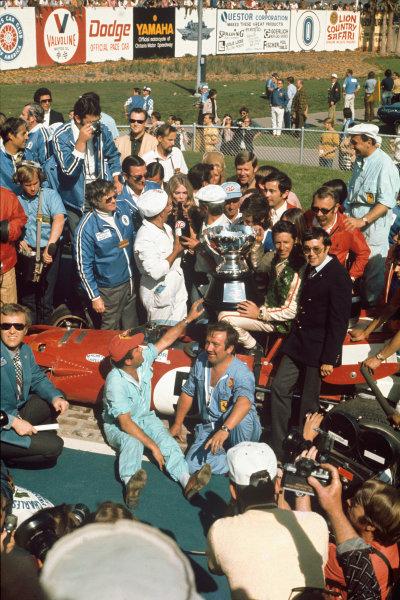 Ontario Speedway, California, USA. 24th - 28th March 1971. Mario Andretti (Ferrari 312B), 1st position, podium. World Copyright: LAT Photographic. Ref: QU 71 04