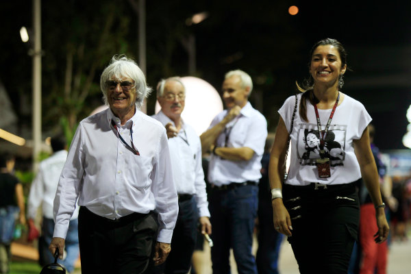 Marina Bay Circuit, Singapore. Saturday 21st September 2013. Bernie Ecclestone in the paddock with his wife. World Copyright: Charles Coates/LAT Photographic. ref: Digital Image _X5J9685