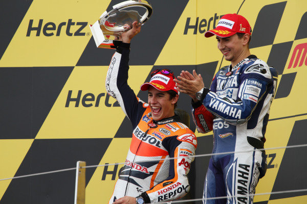 British Grand Prix.  Silverstone, England. 30th August - 1st September 2013.  Jorge Lorenzo, Yamaha, and Marc Marquez, Honda, celebrate on the podium.  Ref: IMG_2488a. World copyright: Kevin Wood/LAT Photographic