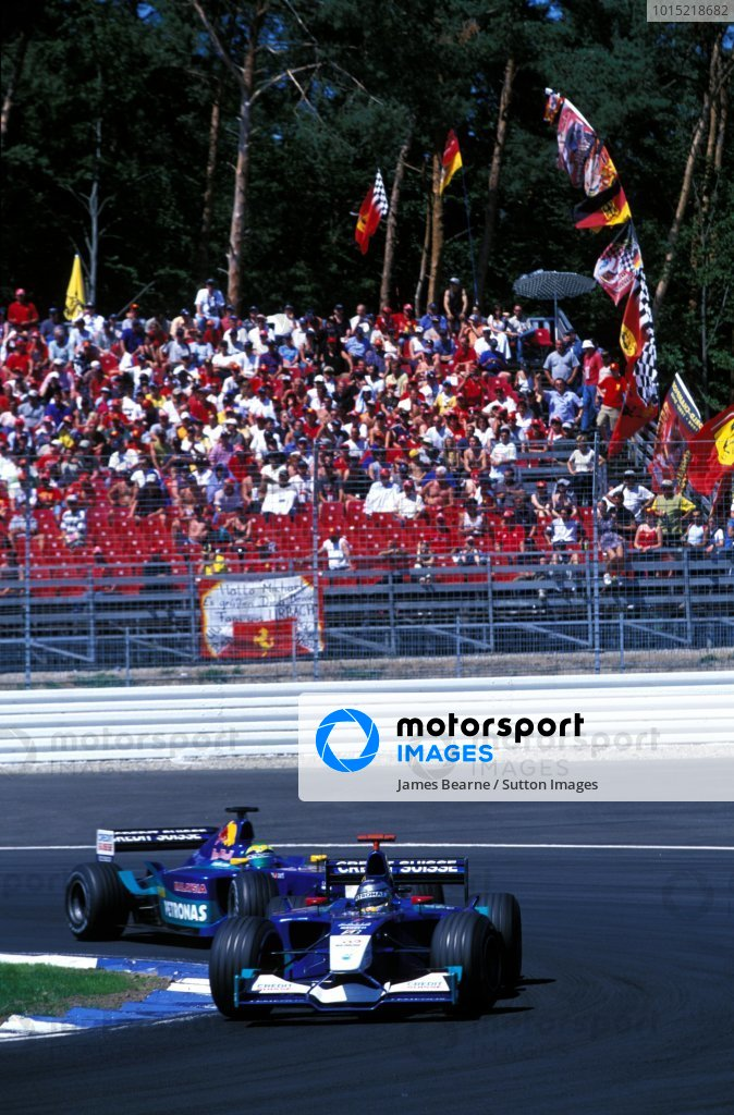 Nick Heidfeld (GER) Sauber Petronas C21 leads team mate Felipe Massa (BRA).Formula One World Championship, Rd12, German Grand Prix, Hockenheim, Germany. 28 July 2002.BEST IMAGE