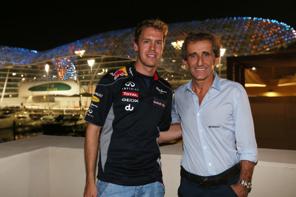 Four time World Champions Sebastian Vettel (GER) Red Bull Racing and Alain Prost (FRA). Formula One World Championship, Rd17, Abu Dhabi Grand Prix, Practice, Yas Marina Circuit, Abu Dhabi, UAE, Friday 1 November 2013. BEST IMAGE