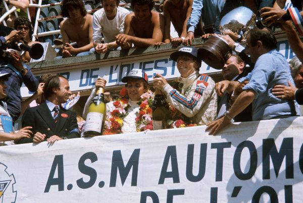 Le Mans, France. 12 - 13 June 1976 Jacky Ickx/Gijs van Lennep (Porsche 936), 1st position, podium, portrait. World Copyright: Murenbeeld/LAT PhotographicRef: 76LM34.