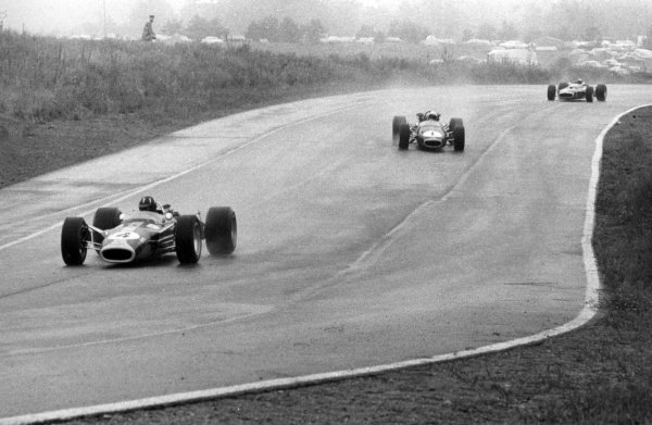 1967 Canadian Grand Prix.Mosport Park, Canada. 27 August 1967.Graham Hill, Lotus 49-Ford, 4th position, leads Jack Brabham, Brabham BT24-Repco, 1st position, and Jackie Stewart, BRM P83, retired, action.World Copyright: LAT PhotographicRef: b&w print
