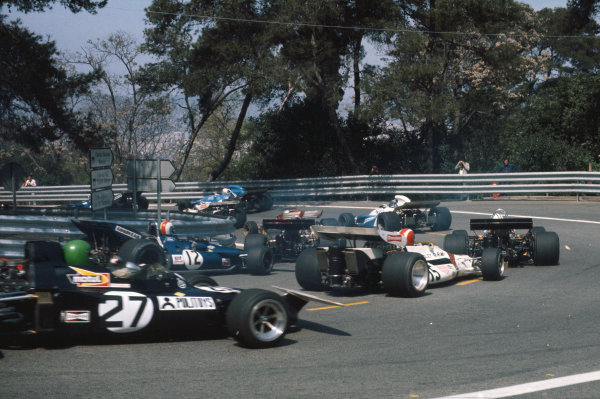 1971 Spanish Grand Prix.  Montjuich Park, Barcelona, Spain. 16-18th April 1971.  Group action at the start as Henri Pescarolo, March 711 Ford, follows Jo Siffert, BRM P160, and François Cevert, Tyrrell 002 Ford, into the hairpin.  Ref: 71ESP01. World Copyright: LAT Photographic