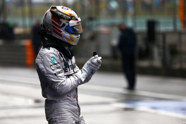 Shanghai International Circuit, Shanghai, China. Saturday 19 April 2014. Lewis Hamilton, Mercedes AMG, celebrates pole in Parc Ferme. World Copyright: Andy Hone/LAT Photographic. ref: Digital Image _ONZ5289