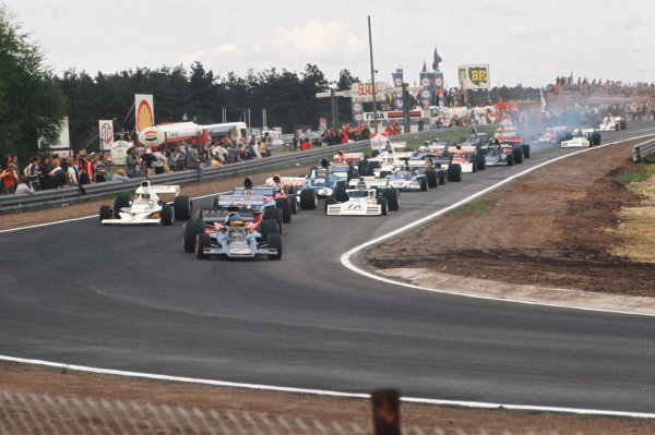 1973 Belgian Grand Prix.  Zolder, Belgium. 18-20th May 1973.  Ronnie Peterson, Lotus 72E Ford, leads at the start from Jacky Ickx, Ferrari 312B3, François Cevert, Tyrrell 006 Ford, Denny Hulme, McLaren M23 Ford, Jean-Pierre Beltoise, BRM P160E, and Carlos Reutemann, Brabham BT42 Ford.  Ref: 73BEL72. World Copyright: LAT Photographic