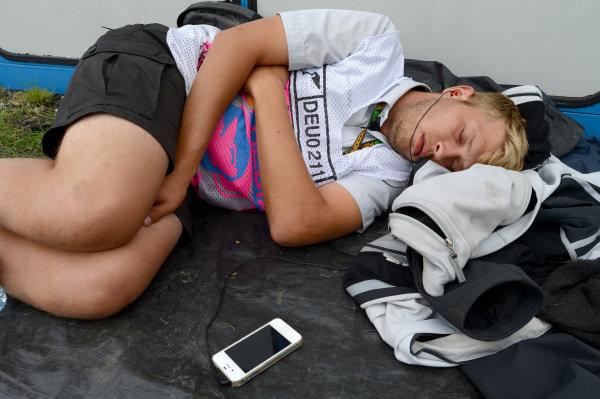 A Marshal asleep. Formula One World Championship, Rd9, German Grand Prix, Practice, Nurburgring, Germany, Friday 5 July 2013.