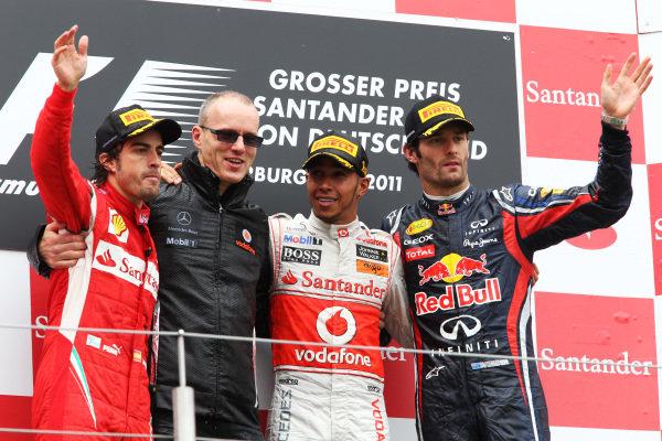 The podium (L to R): Fernando Alonso (ESP) Ferrari, Simon Roberst (GBR) McLaren, Lewis Hamilton (GBR) McLaren and Mark Webber (AUS) Red Bull Racing on the podium.  Formula One World Championship, Rd 10, German Grand Prix, Race, Nurburgring, Germany, Sunday 24 July 2011.  BEST IMAGE
