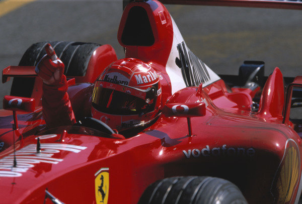 Michael Schumacher, Ferrari F2003 GA, celebrates after winning the race