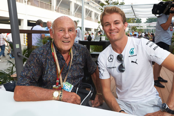 Marina Bay Circuit, Singapore. Sunday 21 September 2014. Nico Rosberg, Mercedes AMG, and Sir Stirling Moss. World Copyright: Steve Etherington/LAT Photographic. ref: Digital Image SNE20610