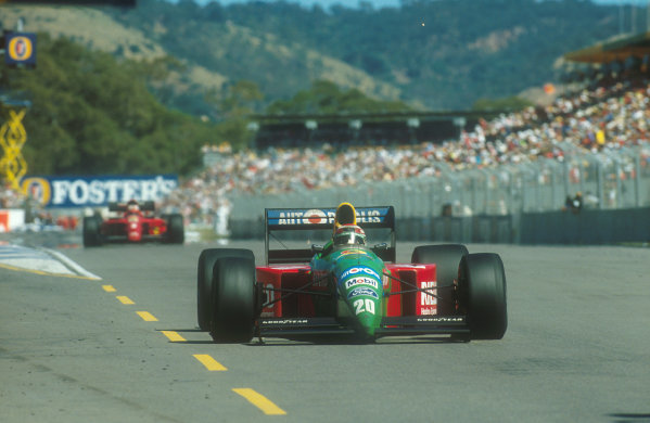 1990 Australian Grand Prix.Adelaide, Australia.2-4 November 1990.Nelson Piquet (Benetton B190 Ford) with Nigel Mansell (Ferrari 641) behind. They finished in 1st and 2nd positions respectively.Ref-90 AUS 29.World Copyright - LAT Photographic