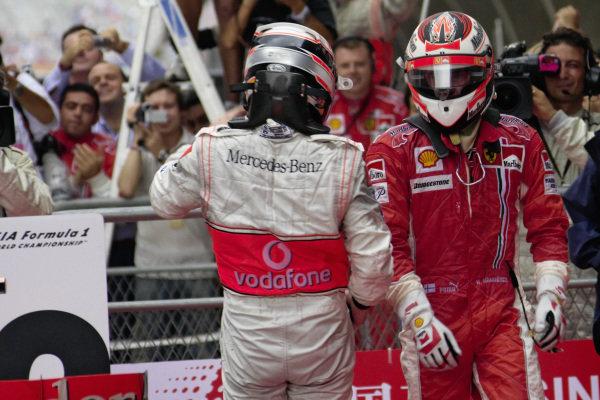 Winner Kimi Räikkönen and 2nd place Fernando Alonso in parc fermé.