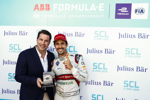 Marco Parroni, Head of Global Sponsoring and Managing Director SA Julius Baer, gives Lucas Di Grassi (BRA), Audi Sport ABT Schaeffler, the pole position award