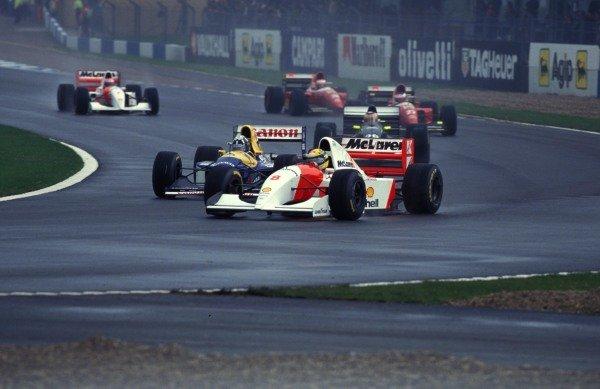 Ayrton Senna, McLaren MP4-8 Ford, leads Damon Hill, Williams FW15C Renault, Karl Wendlinger, Sauber C12, Jean Alesi, Ferrari F93A, Gerhard Berger, Ferrari F93A, and Michael Andretti, McLaren MP4-8 Ford.
