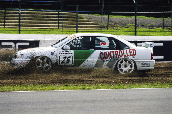 Jamie Wall, Mint Motorsport, Vauxhall Cavalier, spins into the gravel trap.