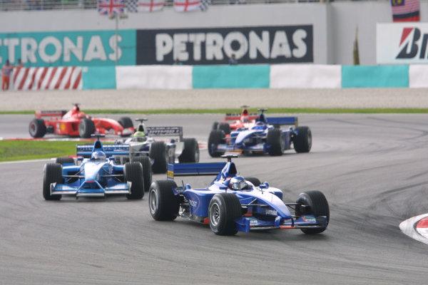2001 Malaysian Grand Prix.Sepang, Kuala Lumpur, Malaysia. 16-18 March 2001.Jean Alesi (Prost AP04 Acer) followed by Giancarlo Fisichella (Benetton B201 Renault) and Ralf Schumacher (Williams FW23 BMW).World Copyright - LAT Photographicref: 8 9MB DIGITAL IMAGE