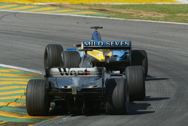 2002 Brazilian Grand Prix - Sunday RaceInterlagos, Sao Paulo. 31st March 2002Jarno Trulli, Renault R202, leads David Coulthard, West McLaren Mercedes MP4/17, action.World Copyright - LAT Photographicref: 12 5mb Digital File Only