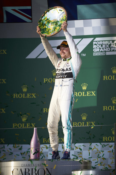 Valtteri Bottas, Mercedes AMG F1, 1st position, holds his trophy up
