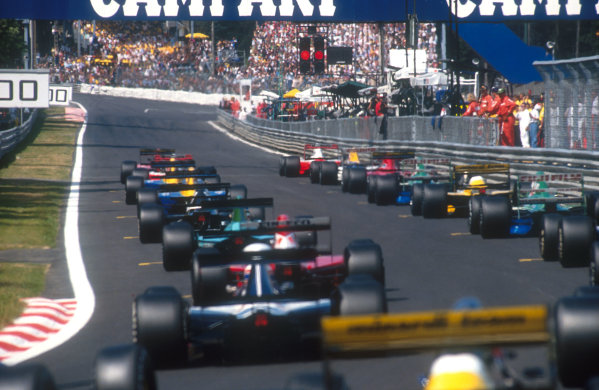 1991 Belgian Grand Prix.Spa-Francorchamps, Belgium. 23-25 August 1991.The field lines up on the grid ready for the start, waiting for the red lights to change as they look down towards La Source Hairpin. Ref-91 BEL 20.World Copyright - Bloxham/LAT Photographic