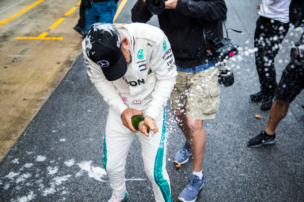 Lewis Hamilton (GBR) Mercedes-AMG F1 celebrates with the team and the champagne