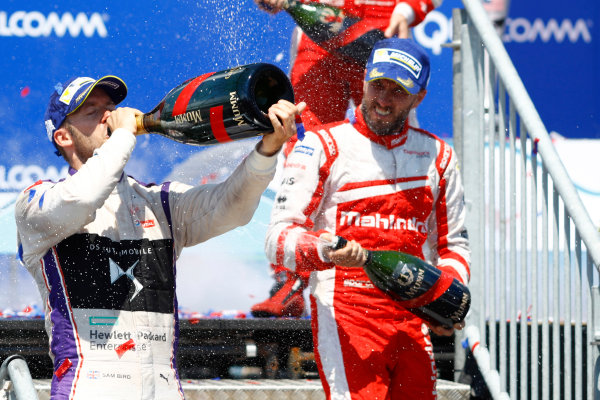 2016/2017 FIA Formula E Championship. Round 10 - New York City ePrix, Brooklyn, New York, USA. Sunday 16 July 2017. Sam Bird (GBR), DS Virgin Racing, Spark-Citroen, Virgin DSV-02, celebrates on the podium after winning the race with Nick Heidfeld (GER), Mahindra Racing, Spark-Mahindra, Mahindra M3ELECTRO. Photo: Alastair Staley/LAT/Formula E ref: Digital Image _R3I1778