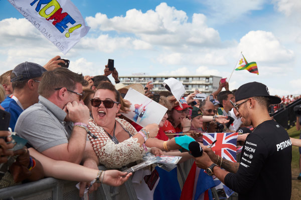 Silverstone Circuit, Northamptonshire, England. Saturday 4 July 2015. Lewis Hamilton, Mercedes AMG, signs autographs for fans. World Copyright: Steve Etherington/LAT Photographic ref: Digital Image SNE18859