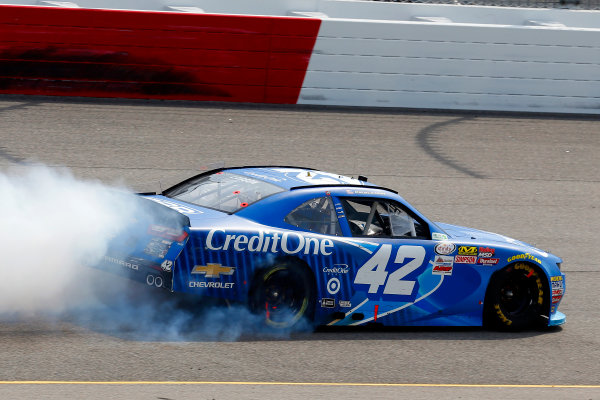 NASCAR Xfinity Series ToyotaCare 250 Richmond International Raceway, Richmond, VA USA Saturday 29 April 2017 Kyle Larson, Credit One Bank Chevrolet Camaro celebrates his win with a burnout World Copyright: Russell LaBounty LAT Images ref: Digital Image 17RIC1Jrl_4696