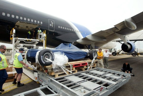 One of the KL Minardi Asiatech PS02 cars in unloaded from the Boeing 747 at Avalon Airport.