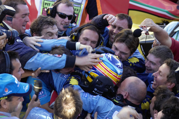 Fernando Alonso is enthusiastically congratulated by his Renault team on a second consecutive world championship title.