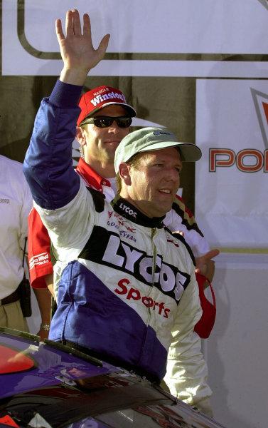 Winner Johnny Benson waves as he climbs from his car.NASCAR Winston West Pontiac Wide Track Grand Prix 200 at California Speedway, Fontana, California, USA, 29 April,2000.-F Peirce Williams 2000 LAT PHOTOGRAPHIC USA