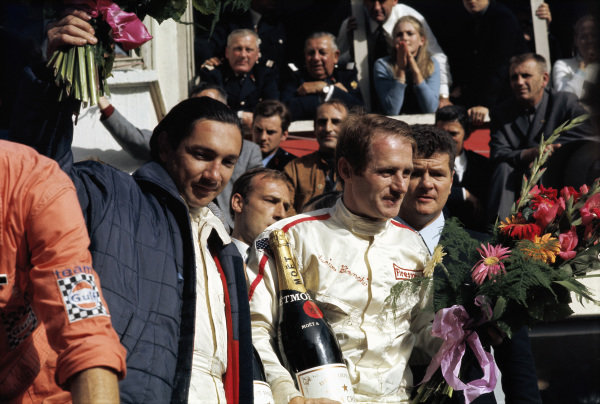 Race winners Pedro Rodriguez and Lucien Bianchi receive their bouquets on the podium.