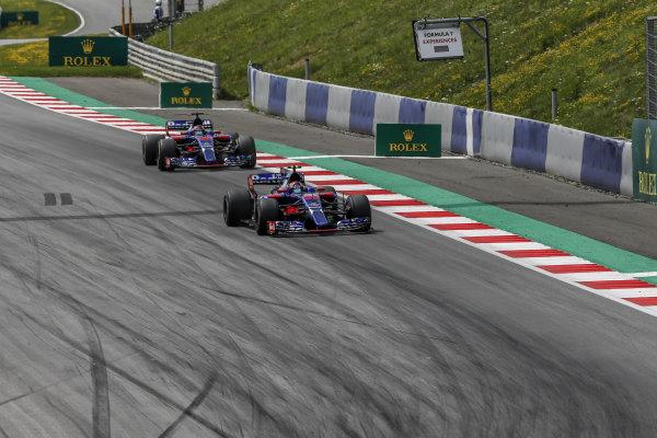 Carlos Sainz jr (ESP) Scuderia Toro Rosso STR12 leads Daniil Kvyat (RUS) Scuderia Toro Rosso STR12 at Formula One World Championship, Rd9, Austrian Grand Prix, Race, Spielberg, Austria, Sunday 9 July 2017.