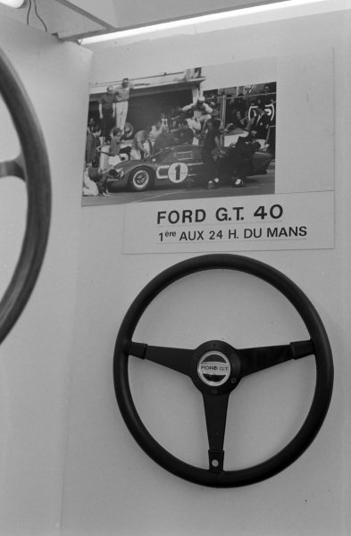 An aftermarket steering wheel with Ford GT40 hub detail.