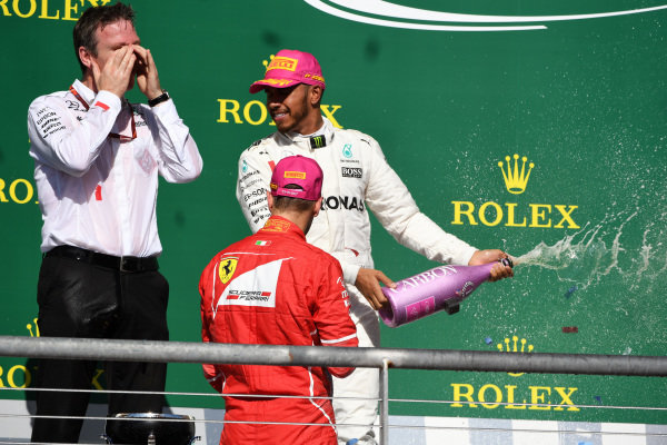 Lewis Hamilton (GBR) Mercedes AMG F1 celebrates on the podium with James Allison (GBR) Mercedes AMG F1 Technical Director and Sebastian Vettel (GER) Ferrari and the champagne at Formula One World Championship, Rd17, United States Grand Prix, Race, Circuit of the Americas, Austin, Texas, USA, Sunday 22 October 2017.